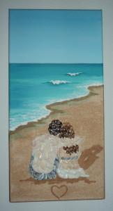 seashell mosaic of couple on a beach