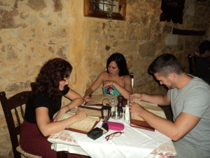 Zoe, Emma & Ash perusing the dinner menu in Chania