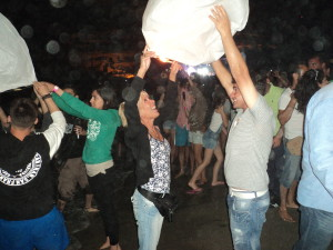 Launching a lantern at Matala