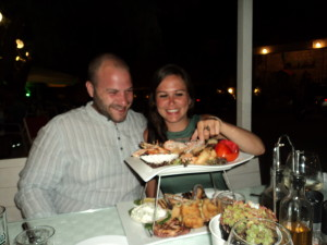 Zoe and Rich with their enormous fish platter at CostAnita restaurant in Almyrida