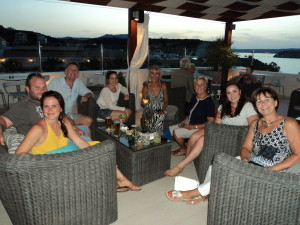 Enjoying a pre-dinner drink onthe Almyrida Residence's Rooftop Garden