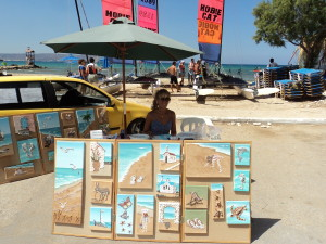 Working on my seashell Mosaics and Collages at the edge of the beach in Almyrida