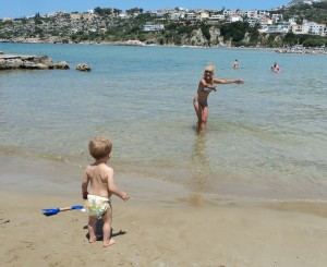 Trying to coax Ralph into the sea!