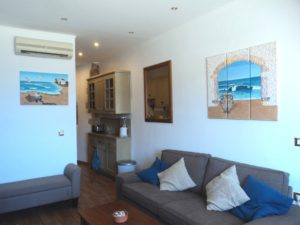 Jenny's Apartment on the Harbour Front in Chania - complete with 2 of my larger Seashell Mosaic Collages - Triptych Archway with Urn & Fisherman & his Boat