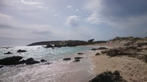 Over on the little island, across the sandbank.