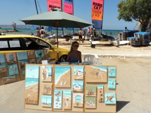 Here I am working on my Seashell Mosaic Collages at the edge of Almyrida Beach
