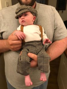 Love this photo! Proud Dad, Rich just couldn't resist dressing Arthur up in cute mini cloth cap & matching braces!