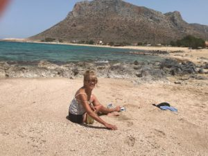 In my element.. amongst a large patch of seashells on one of Stavros' beautiful beaches.