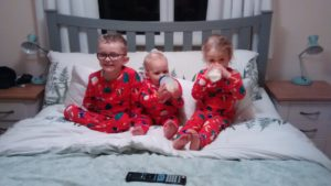 Christmas Eve and kids all ready for bed in their matching Christmas PJ's!