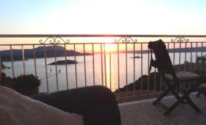 Enjoying the sunset on my balcony sofa after my swim!